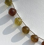 8 inch strand Grossular Garnet Onion Shape Beads