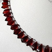 8 inch strand Garnet Gemstone Twisted Tear Drops