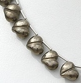 8 inch strand Pyrite Chubby Heart Plain Beads