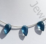 wholesale Blue Topaz Gemstone Conch Briolette