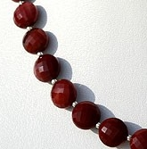 8 inch strand Mookaite Jasper Faceted Coin