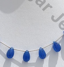 wholesale Navy Blue Chalcedony Carved Fancy beads