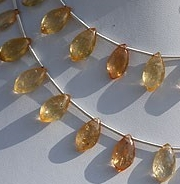 8 inch strand Imperial Topaz Dolphin Briolette