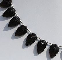 8 inch strand Smoky Quartz Carved Beads