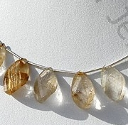 wholesale Golden Rutilated Quartz Twisted Flat Pear