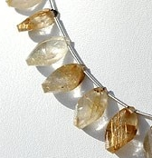 8 inch strand Golden Rutilated Quartz Twisted Flat Pear