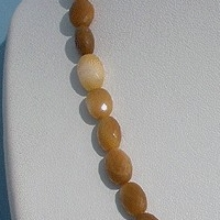 16 inch strand Coral  Oval Faceted