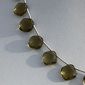8 inch strand Olive Quartz Puffed Diamond Cut