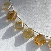 8 inch strand Golden Rutilated Quartz Twisted Heart briolette
