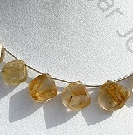 wholesale Golden Rutilated Quartz Twisted Heart briolette