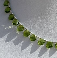 8 inch strand Peridot Gemstone Twisted heart Briolette.