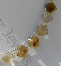 aaa Golden Rutilated Quartz Puffed Diamond Cut