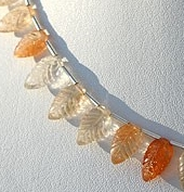 8 inch strand Sunstone Carved Leaf