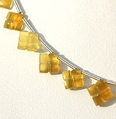 8 inch strand Yellow Opal Clove
