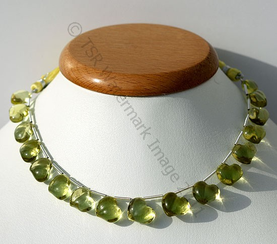 Lemon Quartz Natural Gemstone is varied minerals on earth, possess property of transparent eye clean with vitreous luster and are available in green-gold color with smooth polish, Twin Heart Shape.