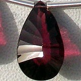 Rhodolite Garnet Both Side Concave Cut